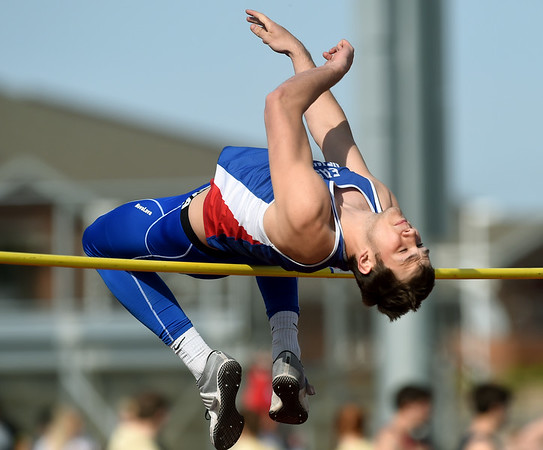 East Newton high jumper Dustin McDermott leaps to a second place finish during the high jump on Friday at Joplin High School.<br /> Globe | Laurie Sisk