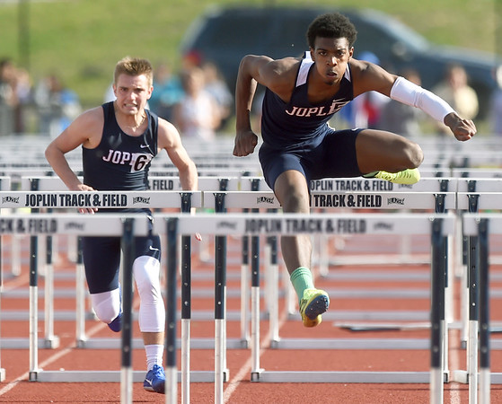 Joplin hurdler Grant Guillory races to a first place finish on Friday at JHS.<br /> Globe | Laurie Sisk