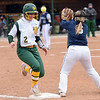 Missouri Southern's Emilee Meyer beats the throw to Lincoln first baseman Rachel Balke during their game on Saturday at MSSU.<br /> Globe | Laurie Sisk