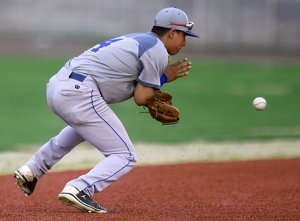 Northeastern Oklahoma's Erasmo Mavarez closes in on a ground ball during the Norsemen's game against Crowder on Tuesday night at Joe Becker.<br /> Globe | Laurie Sisk