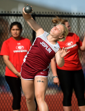 Joplin's Josie Bartlett competes in the shot put on Friday at JHS.<br /> Globe   Laurie Sisk