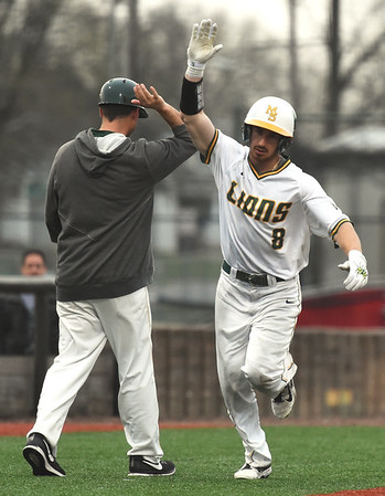 Missouri Southern's Johnny Balsamo rounds the bases after a two-run homerun during the Lions' game against Southwest Baptist on Friday night at Joe Becker.<br /> Globe | Laurie Sisk