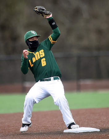 Missouri Southern's Easton Fortuna completes the front end of a successful double play against Southwest Baptist on a blustery day at Warren Turner Field on Saturday.<br /> Globe | Laurie Sisk