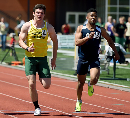 Missouri Southern sprinter Korey Robinette, left battles Oral Roberts' Gavin Steele in their heat of the Men's 100m during the Bill Williams/Bob Laptad Invitational on Friday at MSSU. Robinette finished first in his heat.<br /> Globe | Laurie Sisk