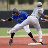 Crowder's Freilin Cabrera eludes the tag of Northeast Oklahoma's Erasmo Mavarez during their game on Tuesday night at Joe Becker.<br /> Globe | Laurie Sisk