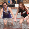 From the left: Thomas Jefferson's Austin Flake and McDonald County's Addy Mick compete in the 2000m steeplechase during the 29th Annual Jock's Nitch PSU Gorilla Relays on Friday at Carnie Smith Stadium.<br /> Globe | Laurie Sisk