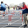 Longtime track official Oscar Birk watches as junior high school athletes compete in the hurdles during a track meet last Thursday at Northeast in Arma. Birk has interacted with an estimated 250,000 athletes during his 37-year career.<br /> Globe | Laurie Sisk