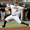 Missouri Southern's Corbin Osburn delivers a pitch during the Lions' game against Southwest Baptist on Friday night at Joe Becker.<br /> Globe | Laurie Sisk