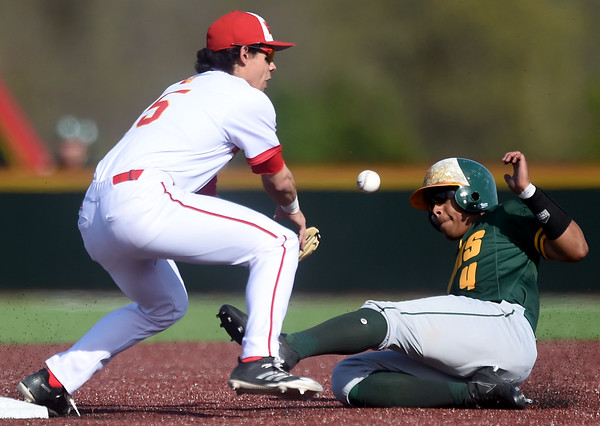 Missouri Southern's Mike Million steals second base as Pittsburg State's Dallas Reed fields the throw during their game on Tuesday at PSU.<br /> Globe   Laurie Sisk