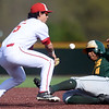 Missouri Southern's Mike Million steals second base as Pittsburg State's Dallas Reed fields the throw during their game on Tuesday at PSU.<br /> Globe | Laurie Sisk