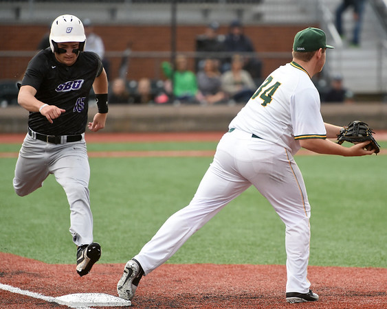 Missouri Southern first baseman Alex Phillips gets the out on Southwest Baptist's Luke Winfrey during their game on Friday night at Joe Becker.<br /> Globe   Laurie Sisk