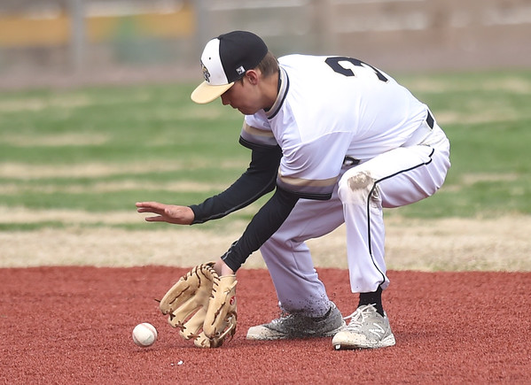 Neosho shortstop Cole Seward fields a sharply hit ground ball during the Wildcats game against Sequoyah on Friday morning at Joe Becker.<br /> Globe   Laurie Sisk