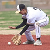 Neosho shortstop Cole Seward fields a sharply hit ground ball during the Wildcats game against Sequoyah on Friday morning at Joe Becker.<br /> Globe | Laurie Sisk