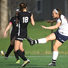 Joplin's xx xx, right, gets a shot off between two Central defenders during a match last week at JHS.<br /> Globe | Laurie Sisk
