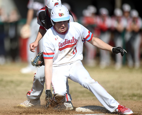 Webb City's Jacob Monroe (11) gets past the tag of Ozark third baseman Forrest Barnes during their game on Tuesday at Webb City.<br /> Globe | Laurie Sisk