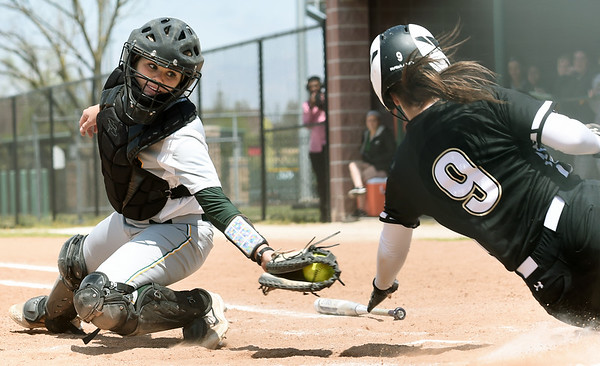 Missouri Southern catcher Angel Badalamenti stretches to try and tag Lindenwood's Megan Clark during their game on Wednesday at Pat Lipiri Field.<br /> Globe   Laurie Sisk