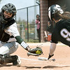 Missouri Southern catcher Angel Badalamenti stretches to try and tag Lindenwood's Megan Clark during their game on Wednesday at Pat Lipiri Field.<br /> Globe | Laurie Sisk