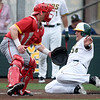 Missouri Southern's Alex Phillips slides home as Pittsburg State catcher Josh Whisler waits for the throw during their game on Wednesday night at Warren Turner Field.<br /> Globe | Laurie Sisk
