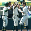 From the left: Missouri Southern players Mike Million and Ryan Hunter congratulate teammate Troy Gagan after Gagan hit a grand slam during the Lions game against Northeastern State on Saturday at Warren Turner Field.<br /> Globe | Laurie Sisk
