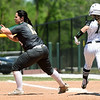 Missouri Southern first baseman Erika Lutgen (13) gets the put out on Northeastern State's Cameron Conrad during their game against on Saturday at Pat Lipira Field.<br /> Globe | Laurie Sisk