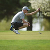 Grant Riley, a sophomore at Carthage High School, lines up a putt on Monday at Schifferdecker Golf Course.<br /> Globe | Roger Nomer
