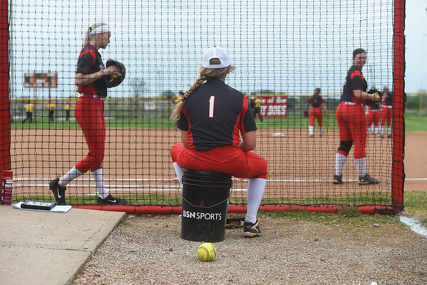 Brooke Bearden watches her teammates warm up before their game at Liberal High School on Monday.<br /> Globe | Roger Nomer