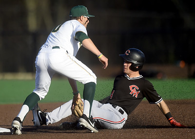 Central Missouri's Dalton Dull (4) slides into second base as Missouri Southern's Denver Coffee (10) applies the tag during their game on Friday night at Warren Turner Field. Globe | Laurie Sisk