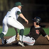 Central Missouri's Dalton Dull (4) slides into second base as Missouri Southern's Denver Coffee (10) applies the tag during their game on Friday night at Warren Turner Field.<br /> Globe | Laurie Sisk