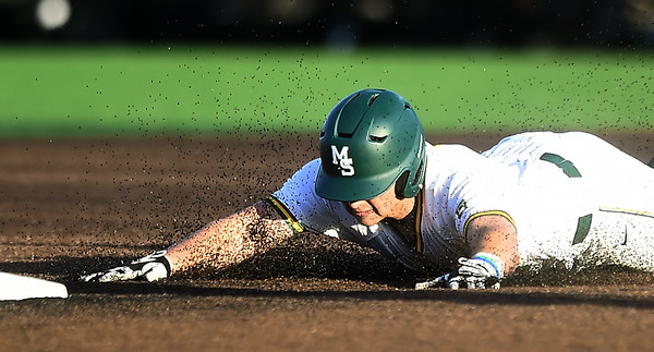 Missouri Southern's Troy Gagan (8) slides into second base for a double during the Lions game against Central Missouri on Friday night at Warren Turner Field. Globe | Laurie Sisk