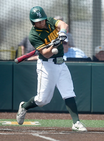 Missouri Southern's Troy Gagan (8) swings at an inside pich during the Lions game against Central Missouri on Saturday at Warren Turner Field. Globe | Laurie SIsk