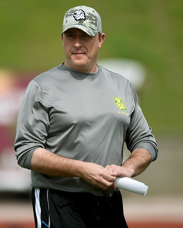 Missouri Southern Head Coach Jeff Sims watches as his players run through drills on Tuesday at Fred G. Hughes Stadium.<br /> Globe | Laurie Sisk