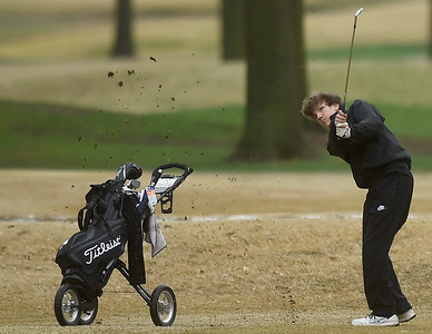 Neosho's Jace Parmley watches his chip shot make its way to the no. 9 green during the Joplin Invitational on Thursday at Twin Hills. Globe | Laurie SIsk