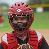 Brooke Bearden smiles from under her catchers mask on senior night at Liberal High School on Monday.<br /> Globe | Roger Nomer