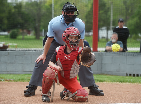 Brooke Bearden catches a ceremonial first pitch before Liberal's game against Diamond on Monday at Liberal High School.<br /> Globe | Roger Nomer