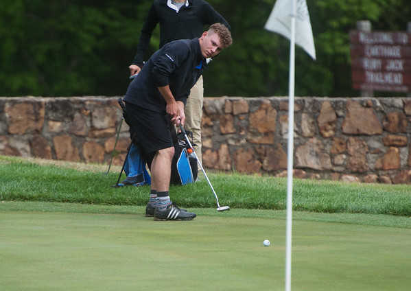 Carthage's Grant Fagg putts on Monday at Carthage Golf Course.<br /> Globe | Roger Nomer