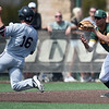 Central Missouri's Erik Webb (16) tries to avoid an interference call as Missouri Southern third baseman Freddie Landera (33) waits to field the ball during their game on Saturday at Warren Turner Field.<br /> Globe | Laurie SIsk