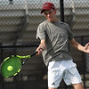 Joplin's Asa Borup returns a serve as he pairs with partner Garret Lewis in their no. 1 doubles match against Carthage's Adam Theis and Eric Ortega on Wednesday at JHS.<br /> Globe | Laurie SIsk