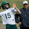 Missouri Southern quarterback Cash Link  runs through drills as offensive coordinator Marty Higgins looks on on Tuesday at Fred G. Hughes Stadium.<br /> Globe | Laurie Sisk