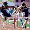From the left: Joplin's Kaian Roberts Day and Nathan Glades battle during the hurdles at the Webb City Invitational on Friday at WCHS. Roberts Day claimed first place while Glades finished third.<br /> Globe | Laurie Sisk