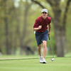 Joplin's Fielding Campbell celebrates after sinking a putt on Monday at Briarbrook Golf Course.<br /> Globe | Roger Nomer