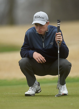 Joplin's Fielding Campbell lines up a putt on the no. 9 green during the Joplin Invitational on Thursday at Twin Hills.<br /> Globe | Laurie SIsk