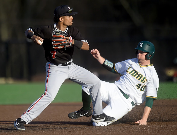 Missouri Southern's Matt Miller (40) tries to break up a double play as Central Missouri's Alex Madera (7) throws to first base during their game on Friday night at Warren Turner Field.<br /> Globe | Laurie Sisk