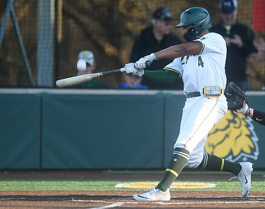 Missouri Southern's Mike Million connects for an rbi double during the Lions game against Central Missouri on Friday night at Warren Turner Field. Globe | Laurie Sisk
