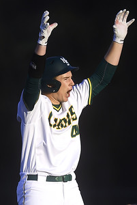 Missouri Southern's Matt Miller celebrates an rbi double during the Lions game against Central Missouri on Friday night at Warren Turner Field. Globe | Laurie Sisk