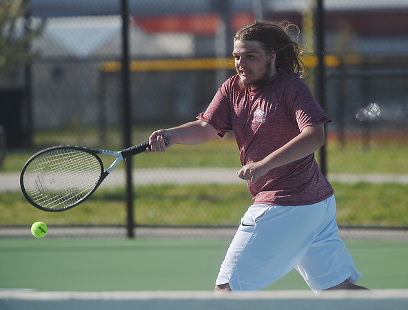 Joplin's Nick Mailes chases down a shot during a match on Monday against Thomas Jefferson at Joplin High.<br /> Globe | Roger Nomer