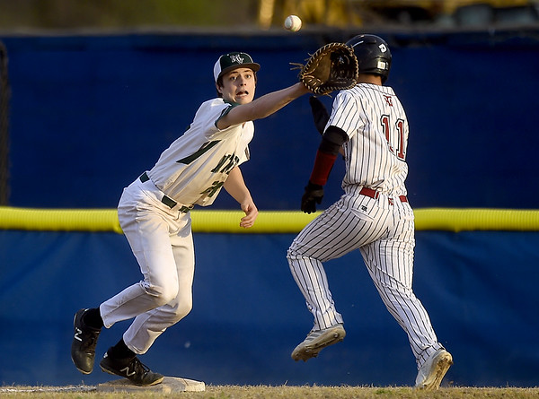 Nevada's Elijah Nadurata (11) outruns the ball to first as Mount Vernons' Cale Miller stretches for the throw during their game of the 45th Annual Bill O'Dell Tournament on Tuesday night at Carthage's Carl Lewton Stadium.<br /> Globe | Laurie Sisk