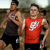 Carl Junction's Lance Ward, right, tries to fend off Nevada's Devin McHugh in the 400m during the Gorilla Relays on Friday at Pittsburg State's Carnie Smith Stadium.<br /> Globe | Laurie Sisk