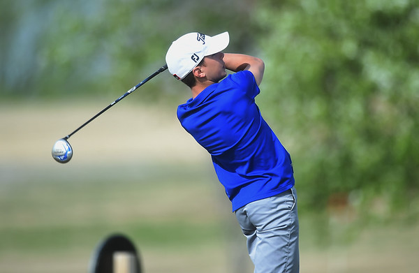 Ethan Satterlee, a College Heights Christian School freshman, tees off on Monday at Schifferdecker Golf Course.<br /> Globe | Roger Nomer