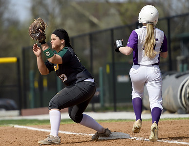 Missouri Southern's Erika Lutgeni (13) gets the put out of Southwest Baptist's Kori Hillenburg (15) during their game on Wednesday afternoon at Lea Kungle Field. Globe | Laurie Sisk