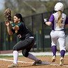 Missouri Southern's Erika Lutgeni (13) gets the put out of Southwest Baptist's Kori Hillenburg (15) during their game on Wednesday afternoon at Lea Kungle Field.<br /> Globe | Laurie Sisk